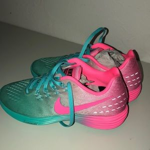 Blue and pink Nike running shoes (never worn).